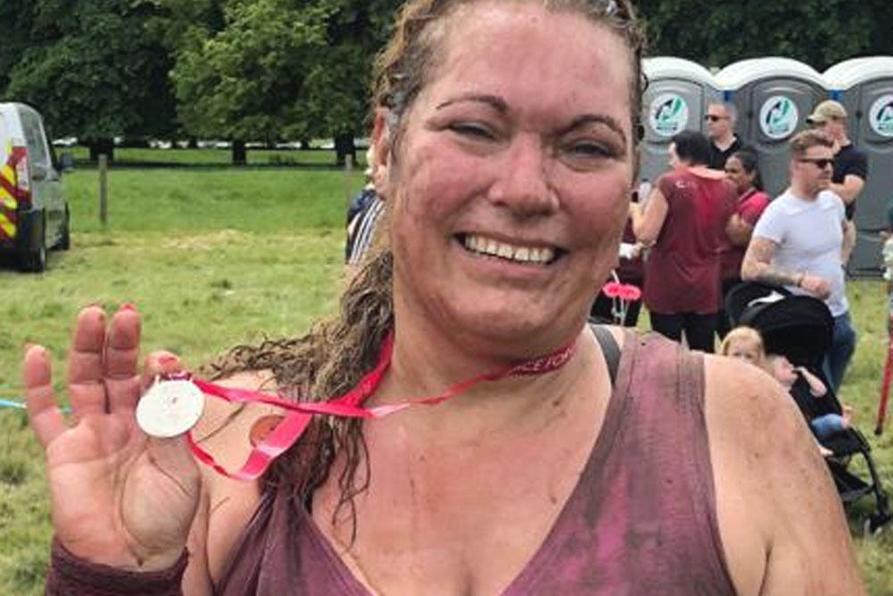 Nicola from Retirement Line completes the 'Pretty Muddy' run for Cancer Research UK